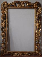 Aged carved wood frame with gold leaf